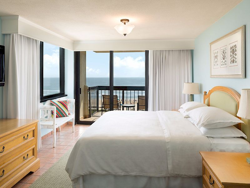 Pearl ocean view guest bedroom with balcony overlooking the beautiful water